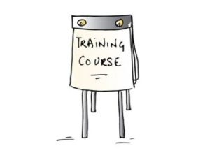 "Cartoon flipchart board with ""training course"" written on it"