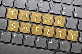 Keyboard with the words THINK SAFETY highlighted on gold keys