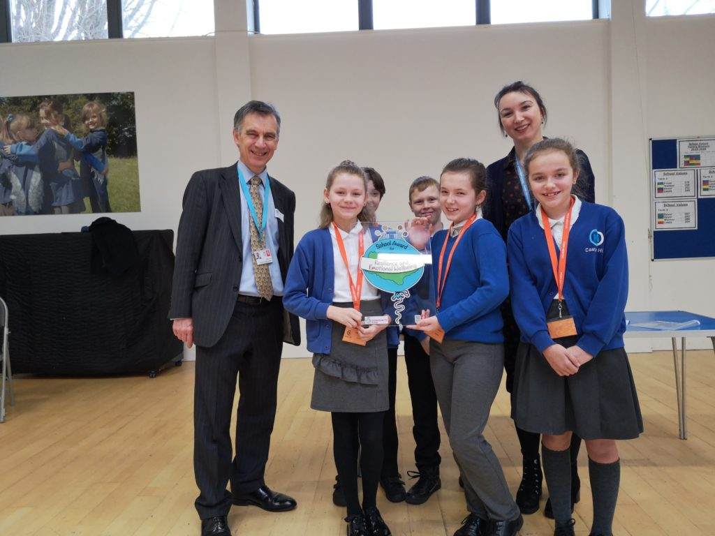 A photo of pupils from Castle Hill primary school holding the Kent Award alongside Councillor Rory Love.