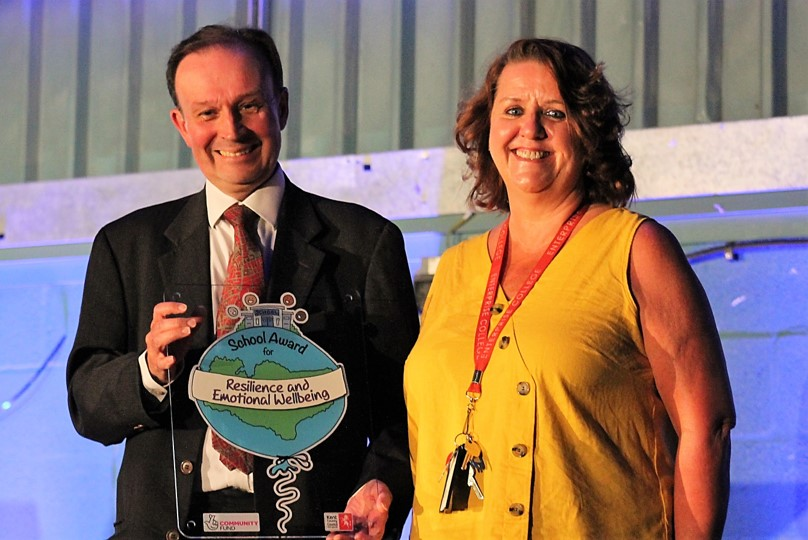 Photo of Roger Gough and a staff member from Homewood School accepting the Kent Award