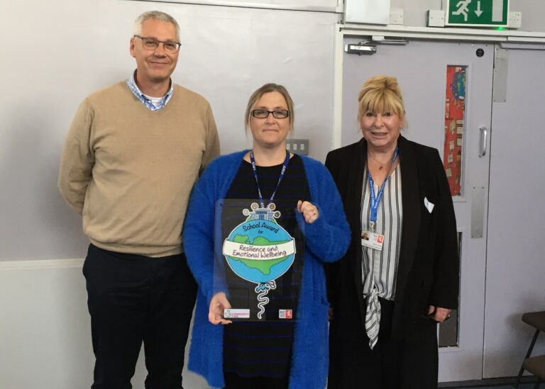 Staff from St Anthony's School are presented with the Kent Award by Cabinet Member Lesley Game.