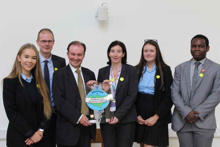 Staff and pupils from St John's School are presented with the Kent Award by Roger Gough.