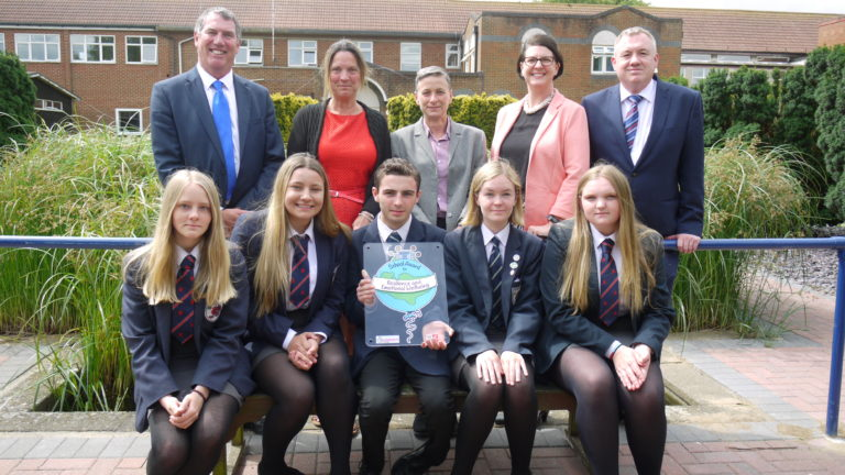 Staff and pupils from Westlands school are presented with the Kent Award by Cabinet Member Mike Whiting.