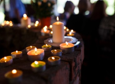 A photo of memorial candles lit inside a building