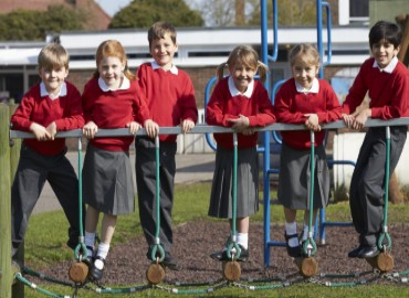A photo of 6 primary aged children outside