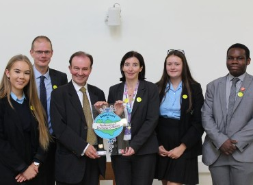 Staff members and pupils from St John's school receiving the Kent Award from Roger Gough