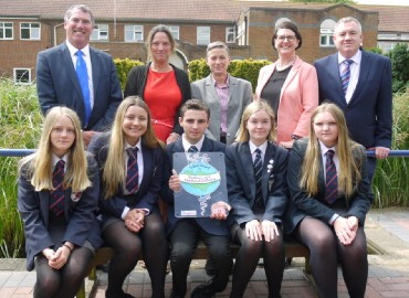 Staff and pupils at Westlands school sitting together and displaying the Kent Award