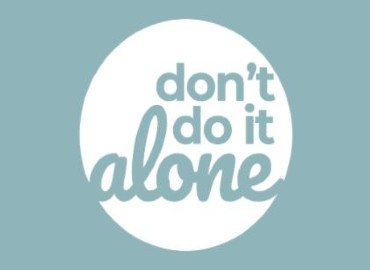 Light blue background with a white circle in the middle, and the words 'don't do it alone' in light blue in the circle